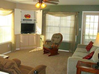 The living room has a 32 inch HDTV, DVD-VCR player. The door walks out to your screen porch.