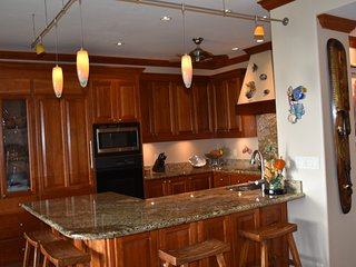 Spacious fully equipped kitchen, subzero refrigerator, dacor oven & cooktop, granite countertop.