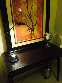 Writing desk for the business traveler includes basic office supplies, Guam guidebook and info