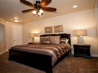 Beautiful master bedroom with walk in closet, en suite, and large flat screen tv