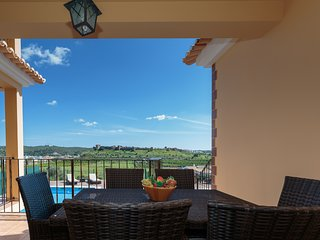 Front terrace dining table with 6 chairs. Magnificent views over Silves town & castle.