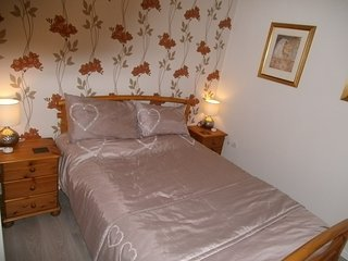 Bedroom 1 - Double, 2 people. With dressing table, clothes rail, hairdryer, iron, fan, full mirror.