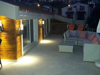 Take in the evening view of Kalkan from the private wrap around roof terrace.