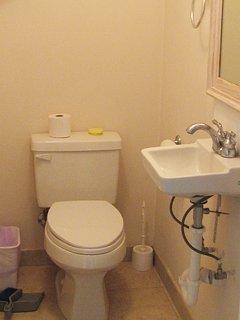 """""""Half bathroom"""" (toilet + wash basin) next to sleeping room downstairs."""