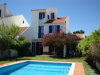 A Lovely Portuguese Villa with large swimming pool.Perfect for Families sleeps 9
