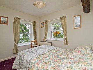 Comfortable double bedroom with oak beamed ceiling with bathroom next door (with shower over bath).