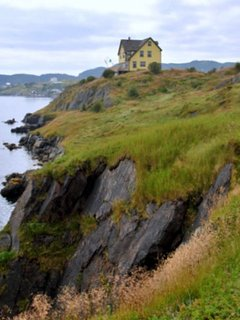 Perched on its cliff, at the top of the 'Nuddick', showing the rugged coastline.