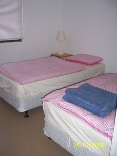 Downstairs second bedroom with two single beds