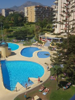 view of pool and bar from balcony