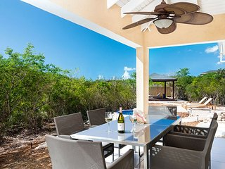 New professionally decorated 3 Bed home located in the private gated community of Thompson's Cove, Providenciales