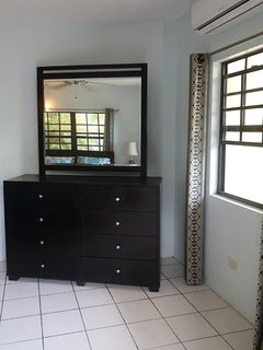 bedroom 1: Dresser w/ mirror