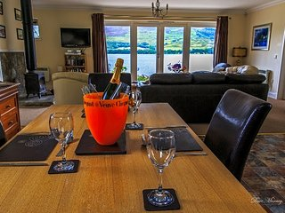 Briar Steading open plan lounge with view of Loch Earn and Briar Cottages Loch Garden -faces south