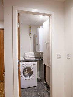 Utility room with washing/ tumble dryer where guests can do their clothes washing..