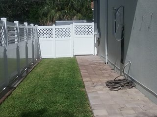 Grass area for dogs with outdoor shower