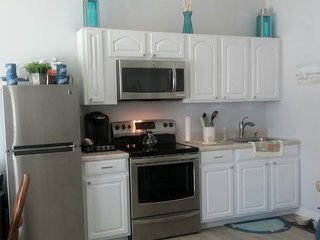 Newly updated kitchen with new appliances including Keurig coffee machine