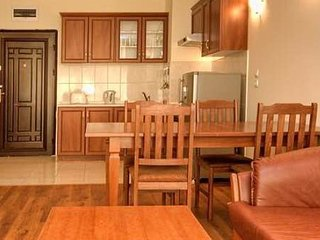 Lounge/dining/kitchen area - separate additional toilet & wardrobe are left of door.