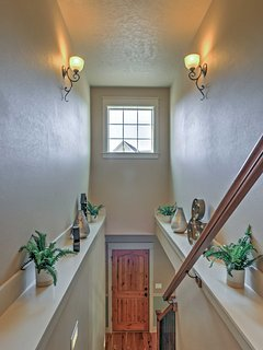 Head up the stairs to find 3 bedrooms and 2 baths.