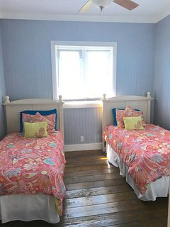 twin beds in guest room are perfect for kids or friends
