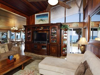 Living room with view of surfers, paddlers and boaters.