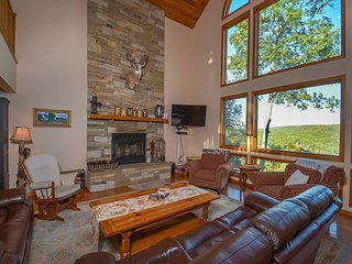 Premiere 5 Bedroom Deep Creek Home showcases stunning panoramic lake views!