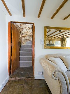 Stairwell with original blue lias stone wall