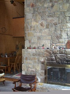 View from Great Room of fireplace and loft.