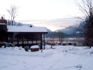 Revelstoke Retreat in winter with Eagle Pass in the background.