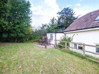 THE STABLES, first floor apartment, private patio, countryside location