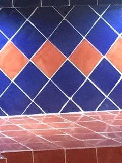 Talavera tiled backsplash.