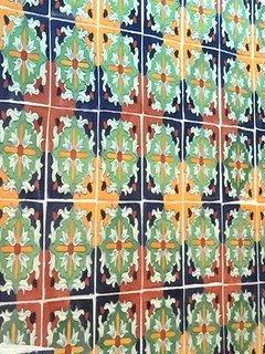 Detailed talavera tiled backsplash.