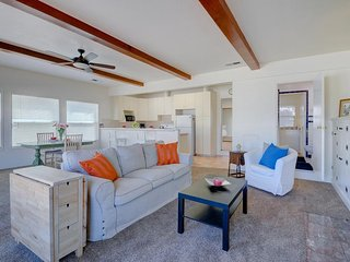 Fun in the sun at this charming, bright and airy duplex - a mile from the beach