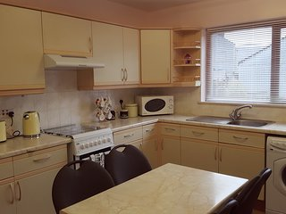 Large Kitchen dining area. Equipped with gas cooker, microwave, fridge and washing machine.