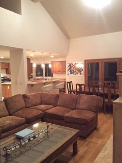 Large living and open floor plan to dining and kitchen with wrap around deck