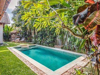 Pool and tropical garden of Villa Can Barca