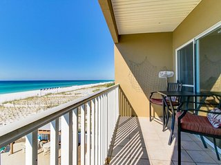 Beachfront delight with sweeping gulf views and shared pool!