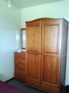 Bed.1 pine double wardrobe. Lots of hangers, dressing table. Spot light, mirror, cases go on top.