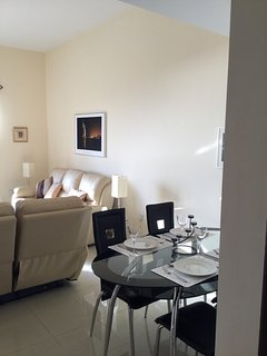 Comfortable lounge with reclining sofas and cable TV (Sports package)
