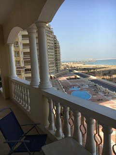 View from the balcony towards the Marina. Swimming pools, playground and gym on the terrace below.