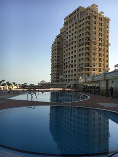 View of the apartment from the swimming pools. Sunbeams and shades available on the terrace.
