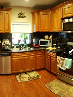 Full updated kitchen to cook and store food. Full Coffee bar.