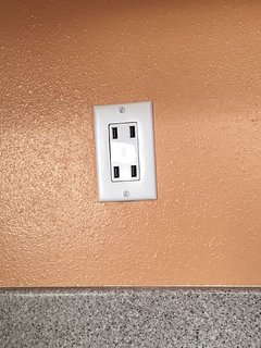 USB 2.0 charger in wall.  Charge up to 4 devices at one time.
