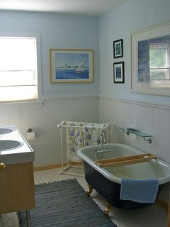 Bathroom #1 has a clawfoot tub.