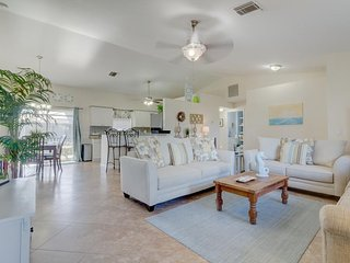 Breezy ranch w/ a screened-in pool, lush views, only 2 miles from the beach!