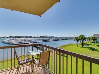 Colorful condo with gorgeous water views, shared pools, dock access and more!