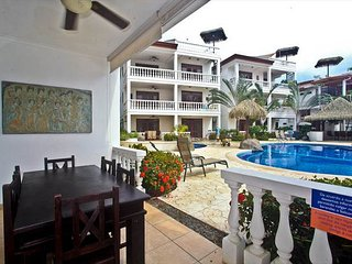 Ground floor, private patio for dining, direct pool & beach access!