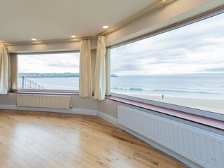 Panoramic views of West Strand from the living and dining rooms.