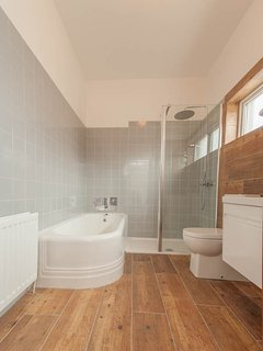 Amazing bathroom with fantastic original huge bath and walk in power shower.