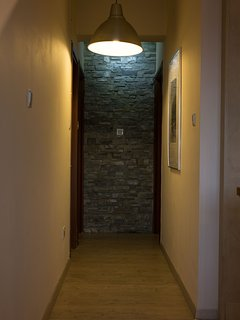 Corridor that leads to the two bedrooms, bathroom and walk in closet.
