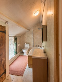 Two of the bedrooms have en suite baths with showers over, two have en suite showers