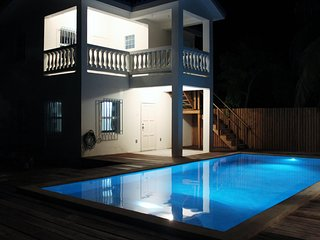 The pool at night with multi-color lights to set the perfect mood.